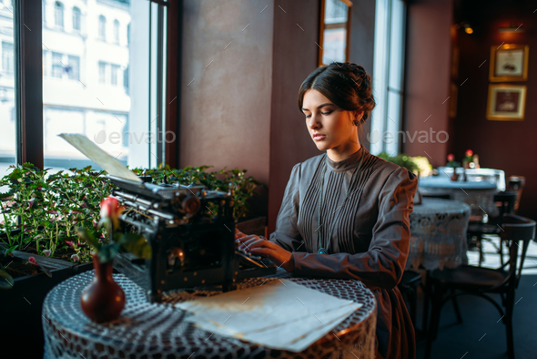 Portrait of beautiful young retro lady in cafe - Stock Photo - Images
