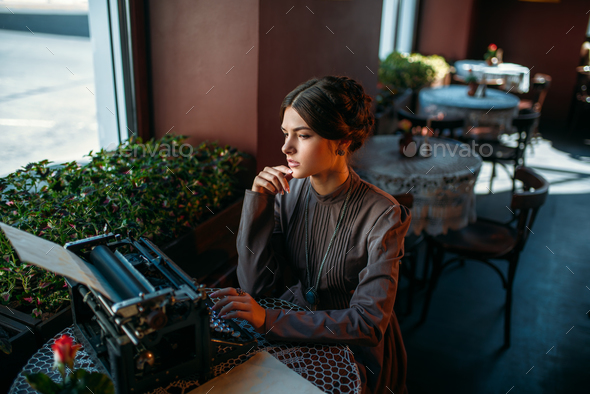 Portrait of beautiful young woman in cafe - Stock Photo - Images