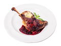 Delicious duck leg confit with red sauce.
