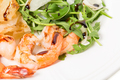 Jumbo shrimp salad with arugula and mango.