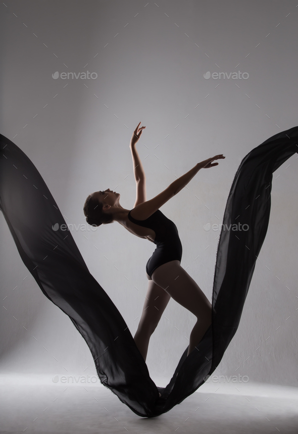 Silhouette of a ballerina dancing on a black cloth - Stock Photo - Images