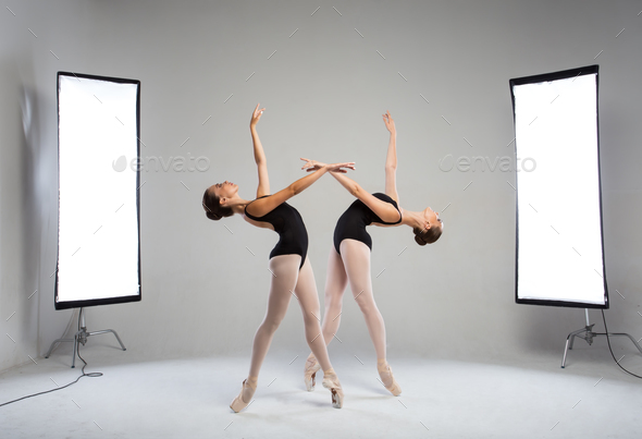 Backstage shooting two graceful dancers in the studio - Stock Photo - Images