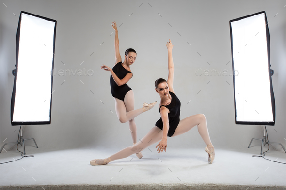 Backstage shooting two beautiful ballerinas in the studio - Stock Photo - Images