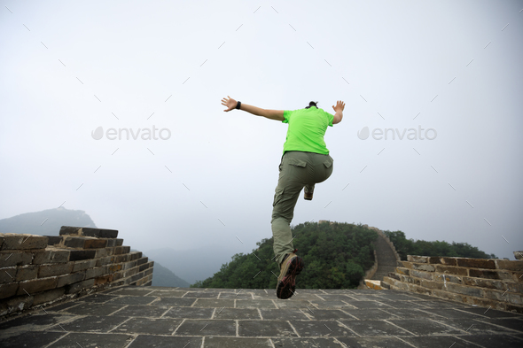 Hipster woman jumping - Stock Photo - Images