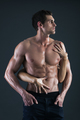 Sexy muscular man and female hands holding his chest