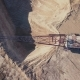 Flying Over the Excavator in a Quarry. Aerial Survey in - VideoHive Item for Sale