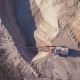 Flying Over the Excavator in a Quarry. Aerial Survey - VideoHive Item for Sale