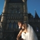 Handsome Romantic Groom and Beautiful Blonde Bride Posing Near Old Wall Castle - VideoHive Item for Sale