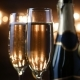 Two Flutes with Sparkling Wine over Holiday Bokeh Blinking Background - VideoHive Item for Sale