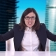 Beautiful Brunette with Glasses Sitting in a Business Suit at Office Desk and Shouts - VideoHive Item for Sale