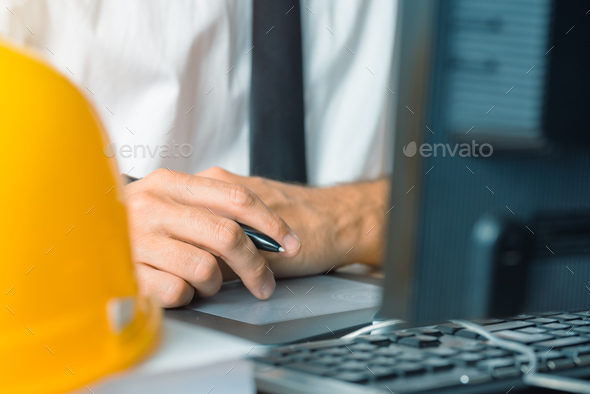 Architect working with sketch pen tablet and CAD software - Stock Photo - Images
