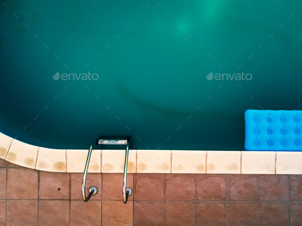 Aerial view of inflatable mattress in swimming pool - Stock Photo - Images