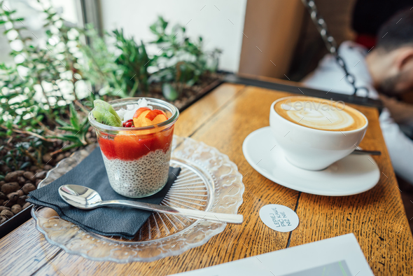 Cappuccino with spoon in cup and dessert - Stock Photo - Images