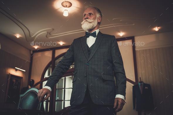 Senior man in luxury interior - Stock Photo - Images