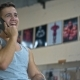 Young Man with Smartphone in Gym Call Friends - VideoHive Item for Sale