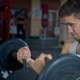 One Sports Bodybuilder Young Man Hard Training Biceps Muscles in Gym