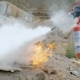 A Man Holds a Fire Extinguisher in His Hands and Extinguishes the Fire Box with a Foam - VideoHive Item for Sale