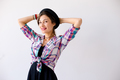 Fashionable brunette with hat studio shot