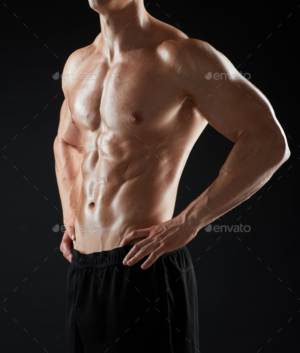 close up of man or bodybuilder with bare torso - Stock Photo - Images