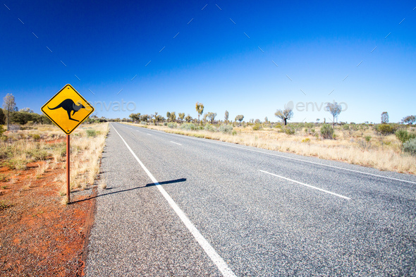 An iconic warning road sign for kangaroos near Uluru in Northern Territory, Australia - Stock Photo - Images