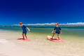 Surfer twin brothers have fun on beach learning to surf - PhotoDune Item for Sale