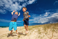 Young happy boys having fun on tropical beach, jumping into the - PhotoDune Item for Sale