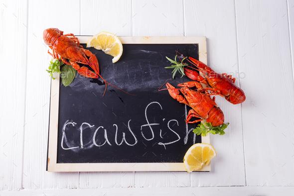 boiled crawfish with fresh lemon - Stock Photo - Images