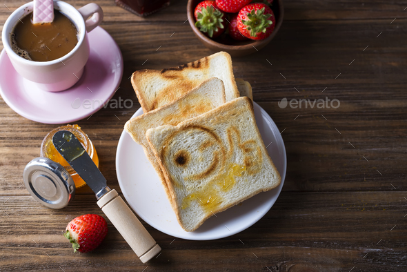 Breakfast with coffee, toasts, strawberry and jam - Stock Photo - Images