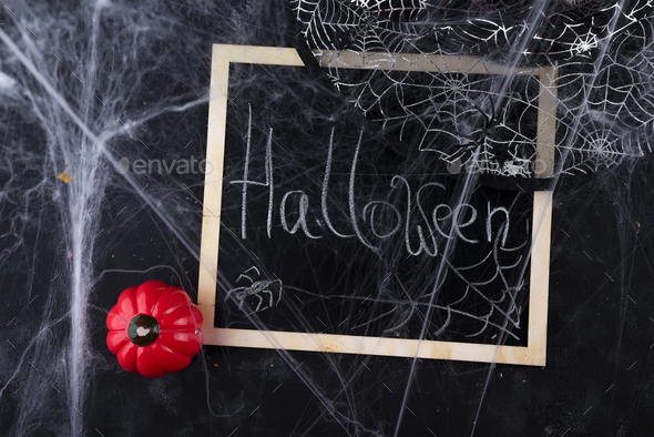 Hat of a witch and a chalkboard - Stock Photo - Images
