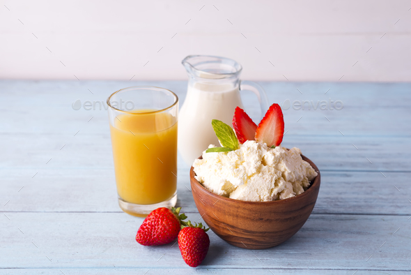 cottage cheese with milk and orange juice - Stock Photo - Images