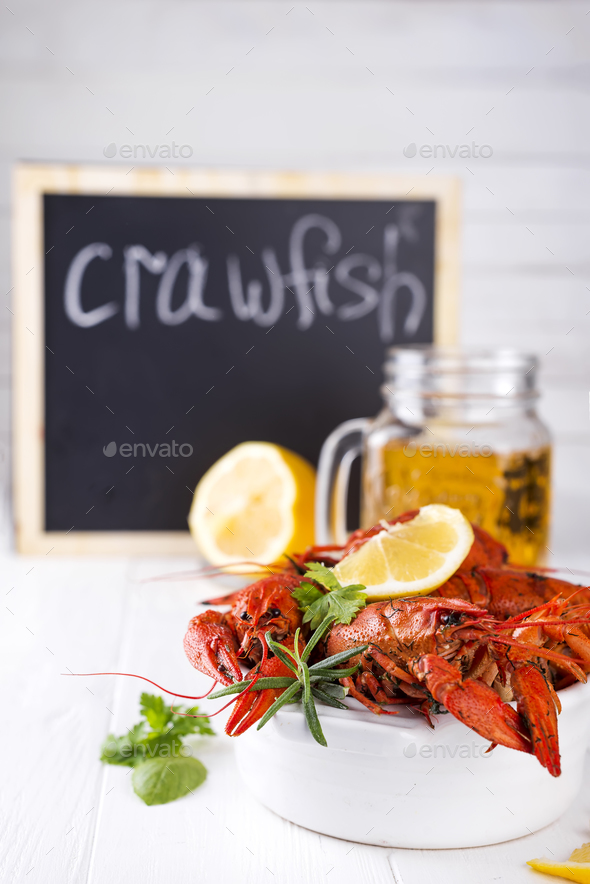Boiled crayfish in the plate with beer - Stock Photo - Images