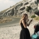 Woman in a Black Dress Doing Makeup on the Side of the Road - VideoHive Item for Sale