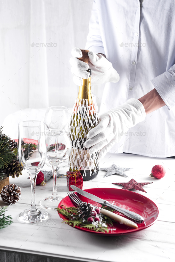 Table served for Christmas dinner in living room - Stock Photo - Images