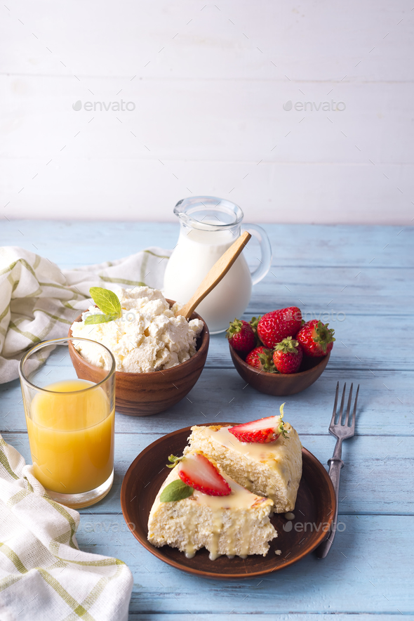healthy breakfast cottage cheese casserole with juice - Stock Photo - Images
