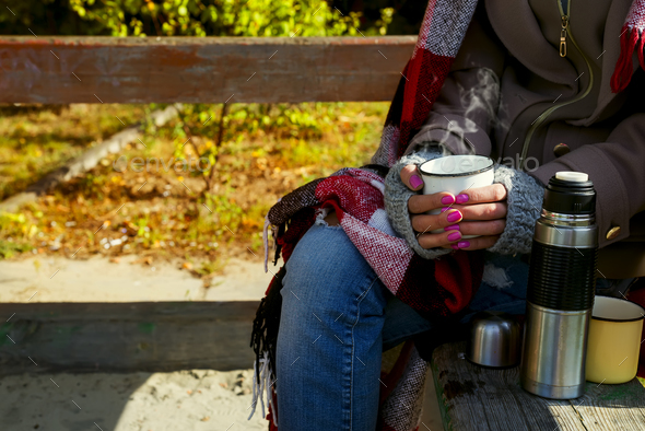 Girl with a cup of hot herbal tea - Stock Photo - Images