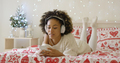 Attractive young woman relaxing at Christmas - PhotoDune Item for Sale