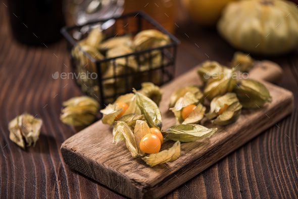 Physalis fruits on wooden board - Stock Photo - Images