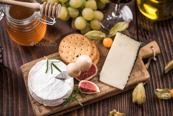 Cheese board with crackers,fig and grapes - Stock Photo - Images