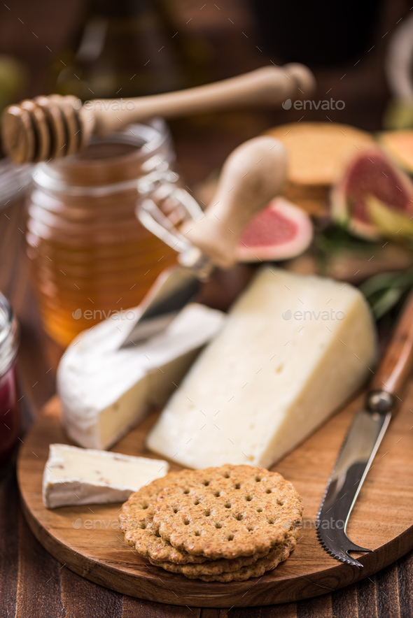 Cheese crackers on board, festive food - Stock Photo - Images