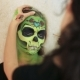 Woman Doing Aquagrim Face Art on Halloween Make-up with Her Hands Tassels Green Scary Glamorous - VideoHive Item for Sale