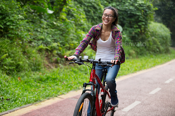 Woman riding bike outdoor - Stock Photo - Images