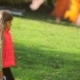 Little Girl Walking in the Autumn Park. Camera Movement to the Profile Along with the Girl's Step - VideoHive Item for Sale