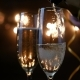 Two Flutes with Sparkling Wine Over Holiday Bokeh Blinking Background. Ultra  Footage. - VideoHive Item for Sale