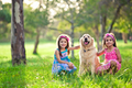 Beautiful little girls and golden retriever - PhotoDune Item for Sale