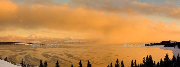 Sunset over steaming Lake Laberge Yukon Canada - Stock Photo - Images
