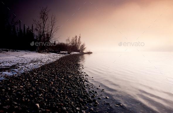 Winter landscape scene Tagish Lake lakeshore Yukon - Stock Photo - Images