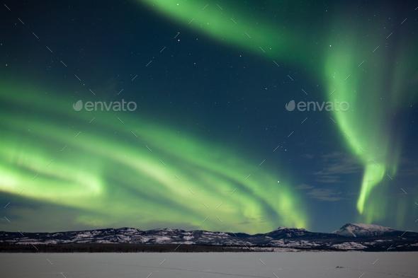 Aurora borealis Northern Lights snowy winter scene - Stock Photo - Images