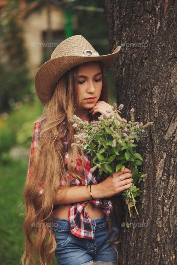 beautiful young cowgirl with long hair - Stock Photo - Images