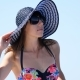 Summer, Sea, Portrait of a Beautiful Young Brunette Woman Wearing a Bathing Suit and Sun Hat - VideoHive Item for Sale