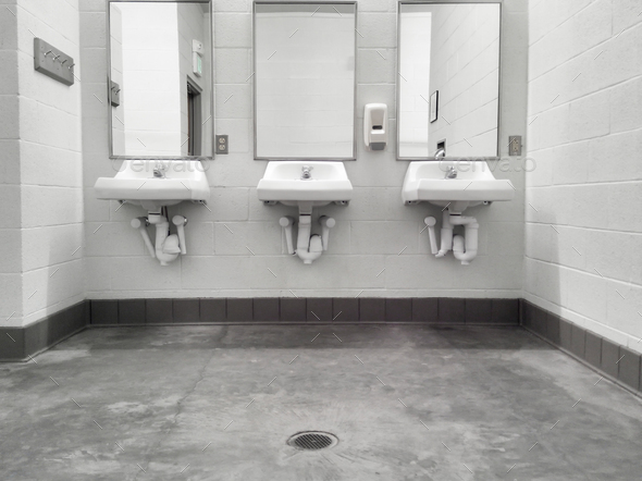 Clean simple public washroom sinks mirrors - Stock Photo - Images